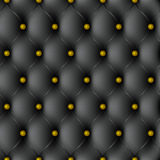 Pattern. Texture black leather upholstery with gold-plated gold carnations Royalty Free Stock Image