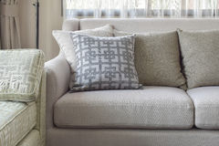 Pattern and texture pillows on beige sofa in living room Stock Photography
