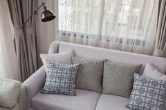 Pattern and texture pillows on beige sofa in the living room Royalty Free Stock Image