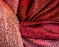 Thai woven fabrics. The pattern of Thai Silk handmade red fabric, red cloth, handmade stock image