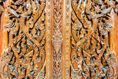 Pattern of Thailand wooden door. Cultural pattern of Thailand wooden door in the temple Royalty Free Stock Photography