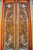 Pattern of Thailand wooden door. Cultural pattern of Thailand wooden door in the temple Stock Photos