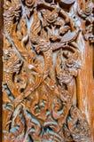 Pattern of Thailand wooden door. Cultural pattern of Thailand wooden door in the temple Royalty Free Stock Images