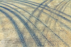 Pattern of tire tracks on cement road. Royalty Free Stock Photo