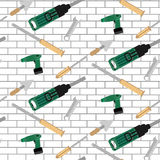 Pattern tools construction on brick wall Royalty Free Stock Images