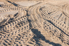 Pattern of tractor wheel printed on sand road use as background Stock Image