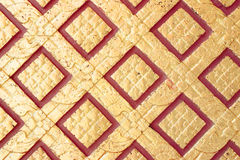 Pattern in traditional Thai style art on wall of the temple Stock Photos