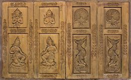 Traditional thai style carved on wood window door. Pattern of traditional thai style carved on wood window door royalty free stock photos