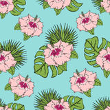 Pattern with tropical leaves and flowers. On a blue background. Seamless Stock Photo