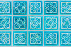 Pattern of turquoise flower glazed tiles. Royalty Free Stock Images