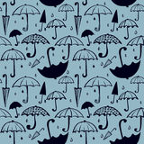 Pattern of umbrellas and drops Stock Images