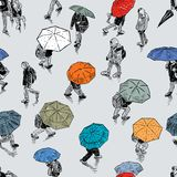 Pattern of the urban pedestrians in the rain Stock Images