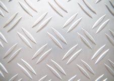 Pattern utformar av stålsätter däckar Arkivfoto