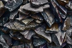 The pattern of the variegated sandstones. Layers of toned colored mica stones. Rock Landslide. Shiny silicate mineral, storage spa Stock Photo