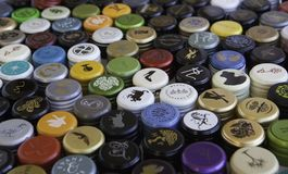 Wine Bottle Caps Pattern. A pattern of various international wine bottle caps with the middle part in focus. caps are often replacing corks in the wine industry royalty free stock photo