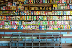 Pattern of vintage candy boxes collctions. Suanpueng, Thailand - December 15, 2014 : The pattern of vintage candy boxes collctions behind the old aligning chairs Royalty Free Stock Image