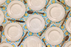 Pattern of vintage dinner plates, knives, forks and spoons Royalty Free Stock Image