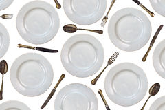 Pattern of vintage dinner plates, knives, forks and spoons Stock Photo