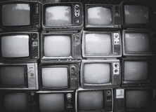 Pattern wall of pile black and white retro television. TV - vintage filter effect style Stock Photography