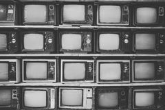 Pattern wall of pile black and white retro television TV. Vintage filter effect style Royalty Free Stock Photo