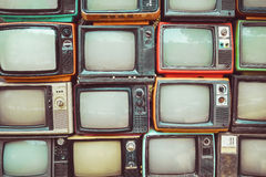 Pattern wall of pile colorful retro television. TV - vintage filter effect style Royalty Free Stock Images