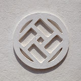 Pattern on the wall in the shape of a swastika Stock Images