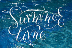 Pattern water texture in a swimming pool and words summer time Royalty Free Stock Images