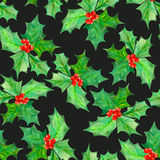 Pattern with watercolor branches with the red berries and green leaves (holly tree). Seamless pattern with branches with the red berries and green leaves (holly Stock Photography