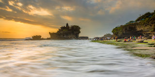 Pattern of Waves - Sunset at Tanah Lot Royalty Free Stock Image
