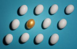 Pattern of white and gold eggs Stock Photo
