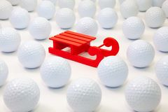 Pattern with white golf balls and Santa Claus red carriage royalty free stock image