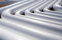 Pattern of a white new pipes Stock Photos
