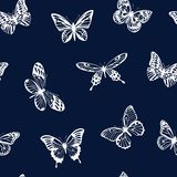 Pattern with white silhouettes of butterflies on blue background. Vector. Stock Image