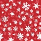 Pattern with white snowflakes Stock Photos