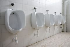 Pattern of white urinals for men in Majorca, Spain, Europe Stock Image