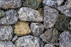 Pattern of wire mash on stone Stock Image