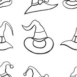 Pattern with witch hats. Stock Images