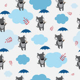 Pattern with wolves. Autumn seamless pattern with cute cartoon wolves, umbrellas, clouds and autumn leaves on a gray background Stock Photography