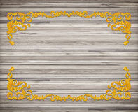 Pattern of wood carve flower gold frame on wood. Background Royalty Free Stock Images