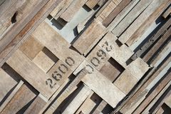 Pattern of wood chips in oblique shape with figures on wall,wall wood background. Close up pattern of wood chips in oblique shape with figures on wall,wall wood stock images