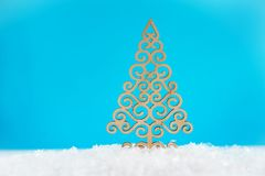 Pattern of a wooden Christmas tree on a blue background. Christmas or New Year concept. Winter card. Pattern of a wooden Christmas tree on a blue background stock photos