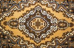 Pattern of a woolen carpet Stock Photo
