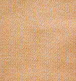 Pattern of woolen knitted fabric Stock Images