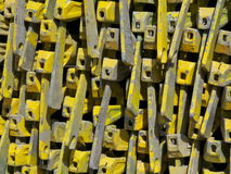 Pattern of yellow scaffolding heads. A pile of yellow scaffolding heads Stock Photo