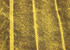 Pattern with yellow stripes painted on asphalt Stock Photography