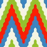 Pattern with zig zag in red, blue and green colors. Seamless geometric pattern with colorful zig zag in red, blue and green colors Stock Photo