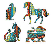 Patterned Animals. Silhouettes of cat, lion, horse and vulture ornate with ethnic abstract pattern. Multicolored animals and bird with tribal ornament. Isolated Royalty Free Stock Photo