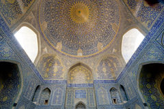 Patterned arches and huge dome inside the ancient persian mosque Stock Image
