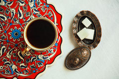 Patterned background of coffee table with cup of morning drink and sugar Royalty Free Stock Photos