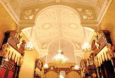 Patterned ceiling with monograms and angels stock photos
